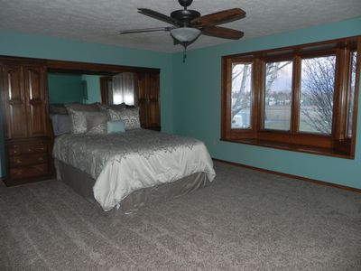 Master bedroom with bay window and new carpet