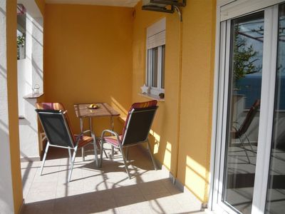 Photo for Four bedroom apartment with terrace and sea view Mali Rat (Omiš)