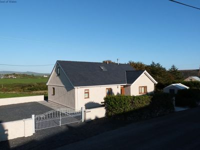 Photo for 5 star holiday cottage in an idyllic, coastal village on the Llyn Peninsula