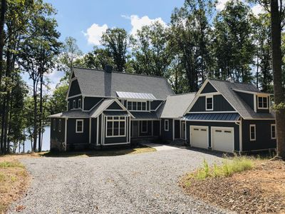 Photo for NEW LISTING! New Lakefront Lake Anna Home; Sleeps 19 in Beds; Two-Slip Boat Dock