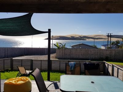 Photo for Stunning views with beach access across the road.