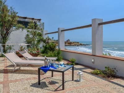 Photo for Elettra, villa facing the sea, on a cliff, just 20 m from the sandy beach