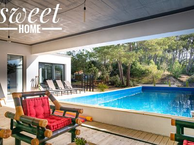 Photo for architect house with heated pool, 250m from the beach, facing the forest