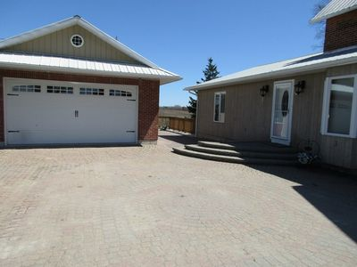 Interlocked driveway with easy access to the garage and the entrance to the house.