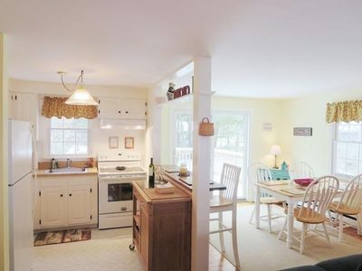 View of open kitchen dining area with breakfast bar - 54 Cranberry Way Chatham Cape Cod New England Vacation Rentals