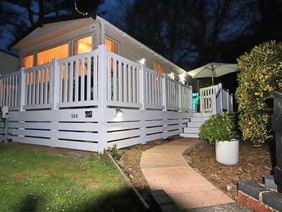 Photo for A PEACEFUL 2 BED STATIC CARAVAN IN A 5* RESORT 5 MINUTES WALK FROM THE BEACH