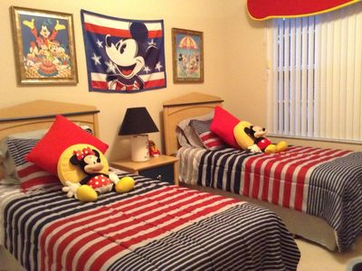 Photo for Disney 20 mins.  4 bed, 3 living/dining, games, utility, kitchen, pool, jacuzzi.