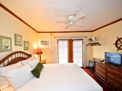 Photo for Quaint studio comfort with shared pool and sun deck - walk into town