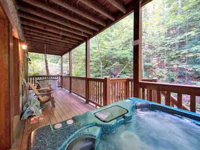 The luxurious outdoor hot tub - As you sit back among the steamy, bubbling water of the hot tub and gaze out at the woods, your tired muscles will relax and any cares will seem to float away.