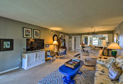The living room features a plush couch, 2 recliners, a flat-screen TV