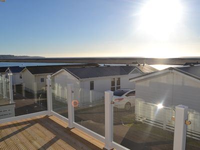 Photo for A luxurious holiday Lodge near Weymouth, with sea views over Chesil Beach