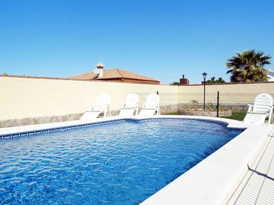 Photo for Lovely apartment for 4 people with private pool, WIFI, TV, pets allowed and parking