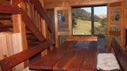 Redgum Cabin Nestled into Mountains