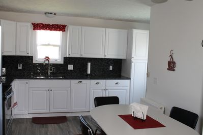 NEW kitchen, granite counter tops, new appliances!  Very clean and open!
