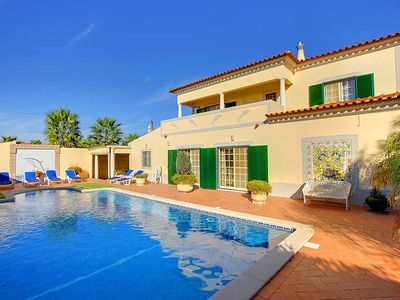 Photo for This 5-bedroom villa for up to 10 guests is located in Carvoeiro and has a private swimming pool and