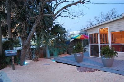 Front porch with deck and screened in area for enjoying morning coffee or sunset