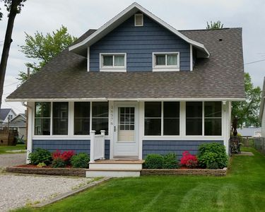 Charming updated cottage with Spring Lake views and 250 ft from public access.