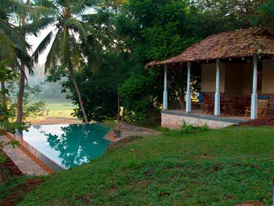 Photo for Stone Well Garden villa - 3 bedroom villa with infinity pool among rice paddies