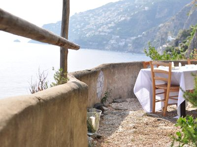 Photo for Romantic villa for 2 people, overlooking the sea, in a natural cliff.