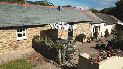 Photo for Delightful cottage with beautiful gardens in peaceful countryside, close to sea.