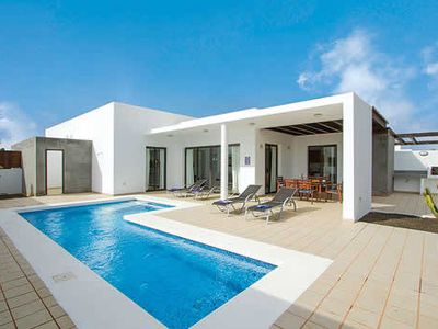 Photo for Stylish villa w/ satellite TV, shaded terrace and inviting private pool