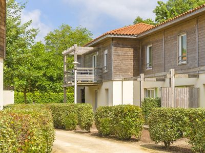 Photo for Charming apartments in a residence with swimming pool near a recreational lake
