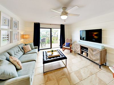 Living Area - Modern beach decor, ample natural light, and cool tiled floors create an inviting vibe.