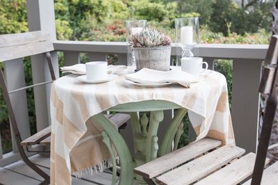 Enjoy your morning coffee here while listening to the birds sing