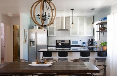 Kitchen overlooks large dining table, with seating for 8.