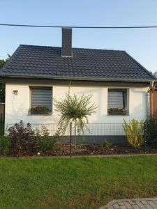 Photo for Idyllic holiday bungalow on the water