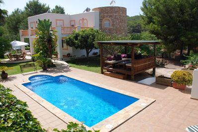over view the villa pool area with 8 sunbeds