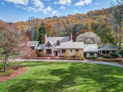 Historic 8 BR Tudor on 3 1/2 Acres.  Private estate and beautiful setting.