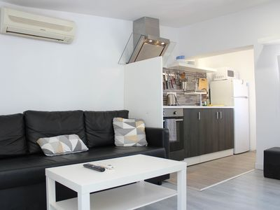 Photo for Apartment with terrace, barbecue and a beautiful view of the city and the sea.