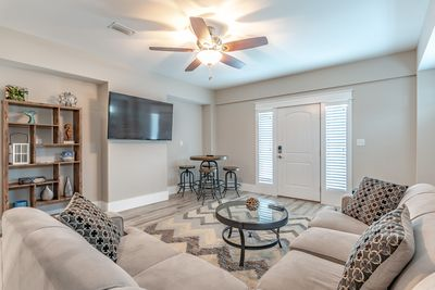 Entryway and cozy second living area with flat screen TV and Queen sleeper sofa.