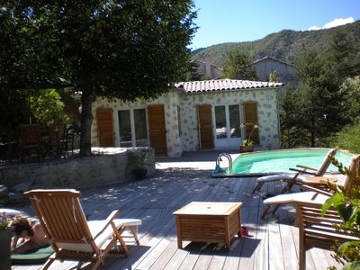 Photo for Stone house 5 ch with swimming pool, panoramic view on the mountain, Entrevaux