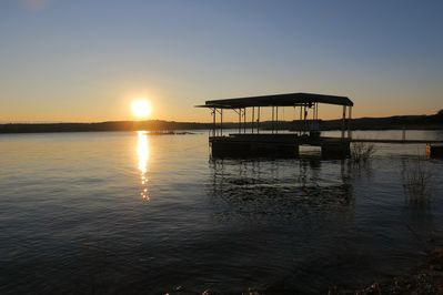 Peaceful sunset at private boat dock.