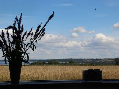 Photo for Holiday apartment with views of fields, water and forest