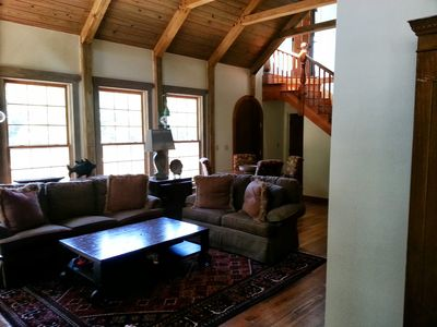 Master carpenter built wood beams in the vaulted living room and kitchen