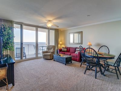 Photo for Oceanfront condo featuring a shared pool w/ a hot tub, walk to beach!