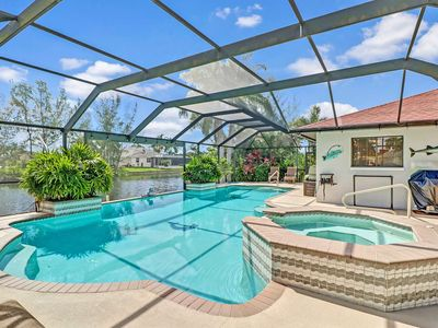 Photo for GORGEOUS! Newly Listed SW Cape Coral Gulf Access Heated Pool & Spa Home! Free Bikes, Kayaks & WiFi!