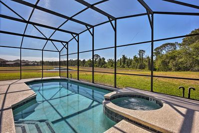 Swim laps under the Florida sun at this Kissimmee vacation rental house.