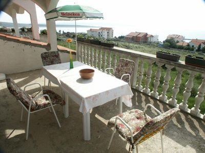 Photo for Two bedroom apartment with terrace and sea view Povljana (Pag) (A-224-a)