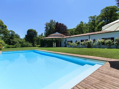 Photo for Eye-catching villa with pool in a huge private park