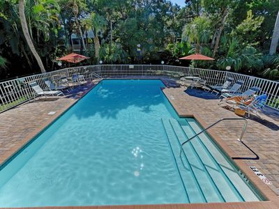 Photo for Two-level condo w/ screened lanai, balcony, & shared pool - walk to the beach!