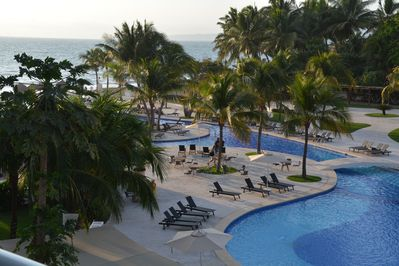 A Beautiful View Across the Pool to the Beach - actual view from our balcony