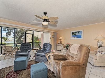 Photo for Boats going by Bayside 118 - 1st fl intercoastal, free wi-fi, central ac, beach access.