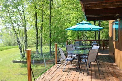 Main Level Deck with 4 tables & 16 chairs, 4 lounge chairs and 2 chaise loungers