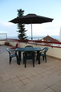Photo for Cozy apartment with large terrace nearby the beach