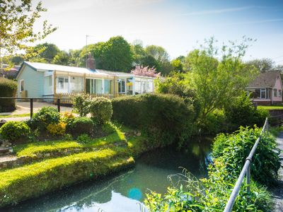 Photo for Homestead, Lyme Regis is a cosy riverside cabin, 10 mins walk from the beach
