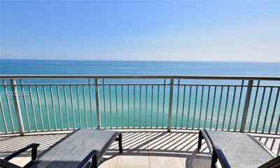 Photo for Live the Ultimate Ocean Front Designer 2 bedroom 2.5 bath condo on the Beach